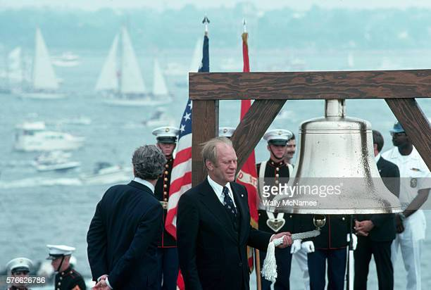 President Ford rings a commemorative bell onboard a US warship in New York Harbor Ford is participating in the American Bicentennial events