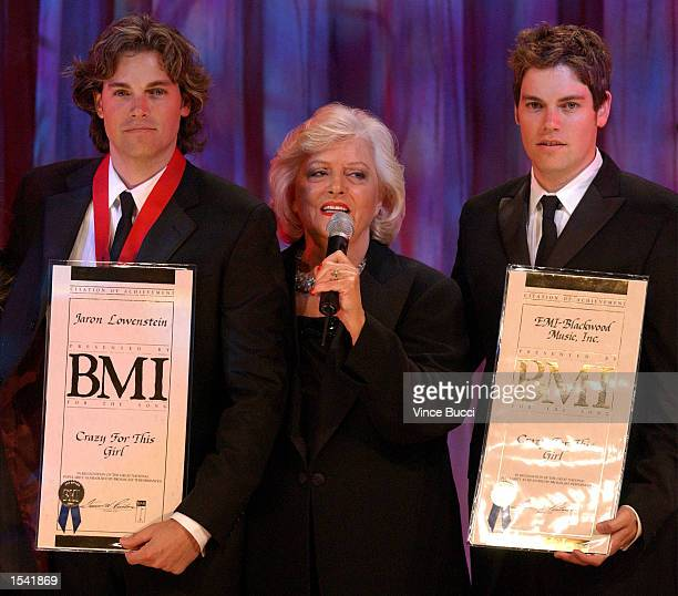President Frances W Preston poses with award recipients musicians Evan and Jaron at the 50th Annual BMI Pop Awards May 14 2002 in Beverly Hills CA