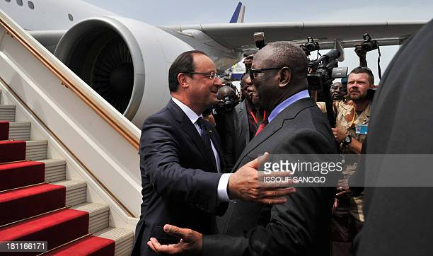 President Francois Hollande of France greets his Malian counterpart Ibrahim Boubacar Keita on September 19 at the Bamako airport Leaders from across...
