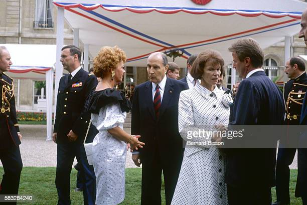 President Francois Mitterrand Danielle Mitterrand and Minister Bernard Kouchner during garden party at the Elysee Presidential Palace for...