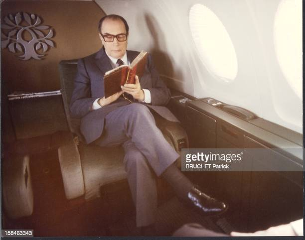 President Francois Mitterrand reading a book aboard his airplane Myster 50 called 'Rambouillet' returning to Toulouse, where he celebrated the official launch of the Airbus 320. Seen above his head his emblem: oak branches (robustness) and olive (peace) on a common core.