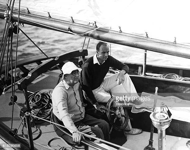 President Franklin D Roosevelt and his son James sail from Marion Massachusetts to Campobello Island on the Amberjack II June 1933 | Location near...