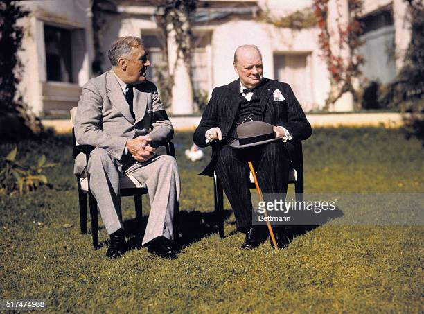 President Franklin D Roosevelt and Prime Minister Winston Churchill talk on the lawn of the President's villa during the Casablanca conference