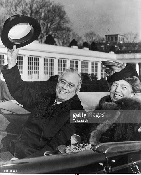 President Franklin D Roosevelt and wife Eleanor Roosevelt smiling and waving from an open car returning from inauguration ceremonies January 20 1941