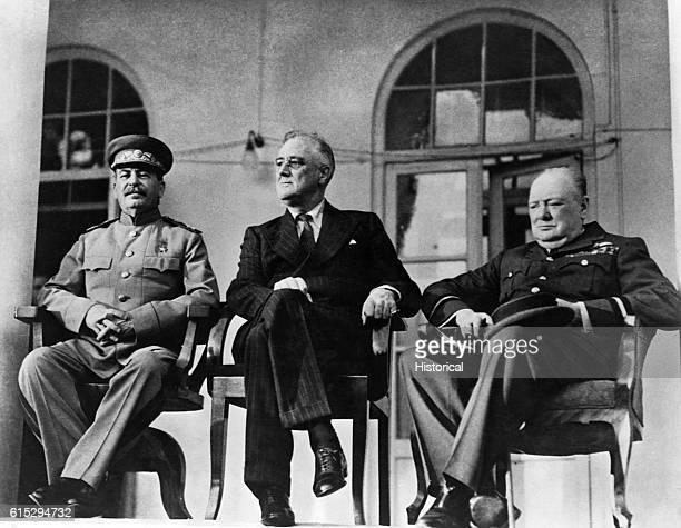 US President Franklin D Roosevelt British Prime Minister Winston Churchill and Soviet Premier Joseph Stalin pose for the press at the Tehran...