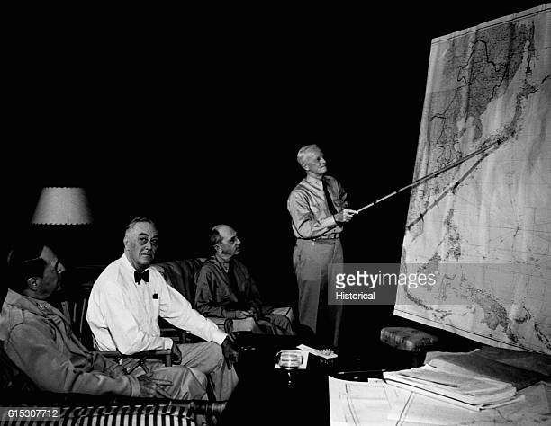 President Franklin D Roosevelt in conference with General Douglas MacArthur Admiral Chester Nimitz and Admiral William D Leahy while on tour in...