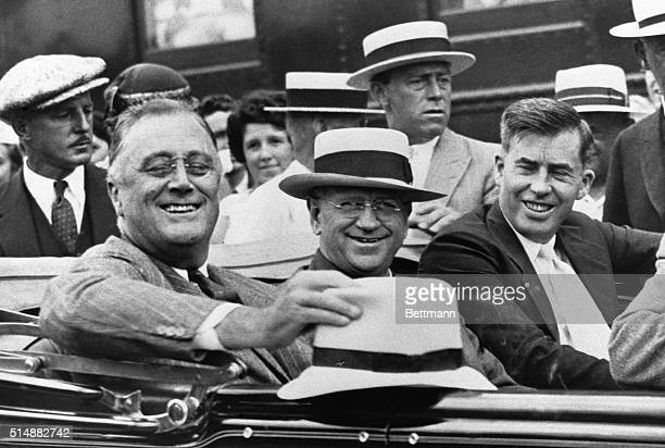 US President Franklin D Roosevelt rides in an automobile with Secretary of the Interior Harold L Ickes and Secretary of Agriculture Henry A Wallace...