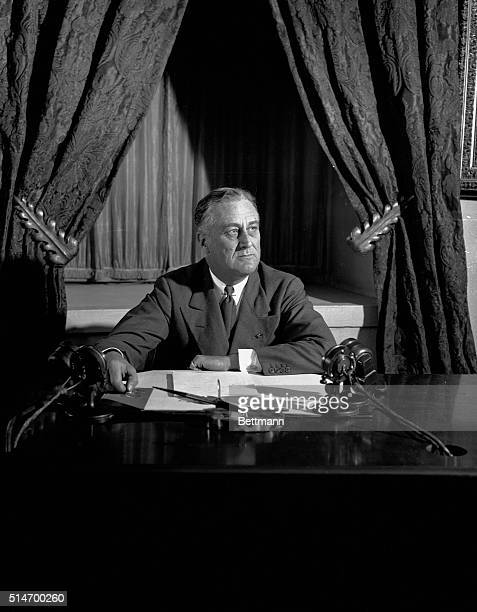 President Franklin D Roosevelt talks over the radio promises honest dollar In nation wide broadcast the President speaks from the White House to the...