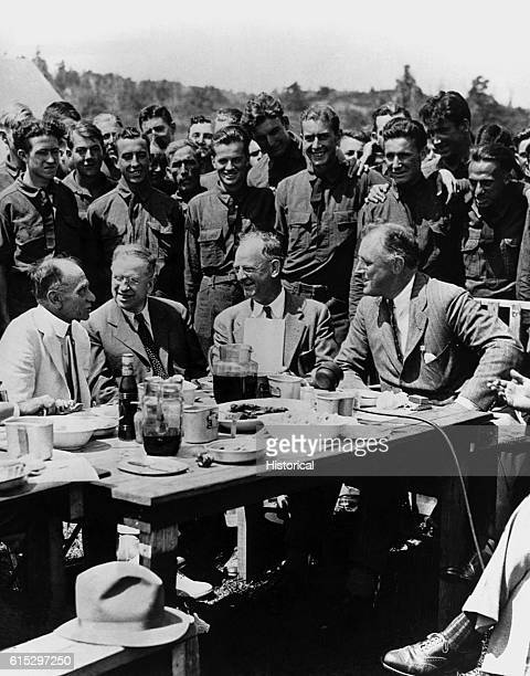 President Franklin D. Roosevelt visiting CCC Camp at Big Meadows in Virginia's Shenandoah Valley. With him are , Louis Howe, Harold Ickes, and Robert...