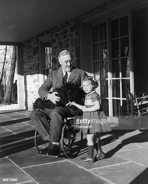 President Franklin D Roosevelt with dog 'Fala' and Ruthie Bie at Hill Top Cottage in Hyde Park New York circa 1940s