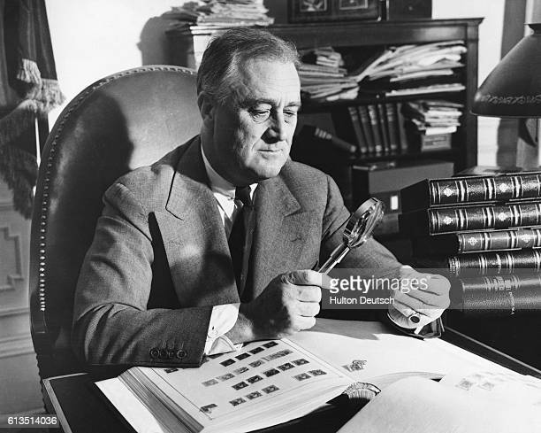 President Franklin Delano Roosevelt an avid stamp collector and member of the American Philatelic Society works on his collection in the Oval Office