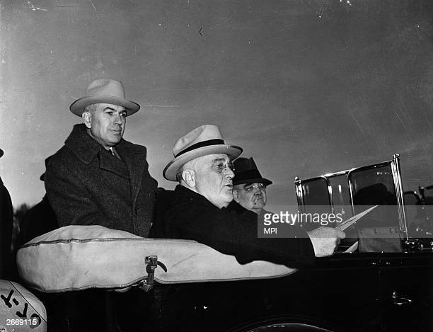 President Franklin Delano Roosevelt and Rex Tugwell , a member of the New Deal brains trust visiting the town of Greenbelt in Maryland.