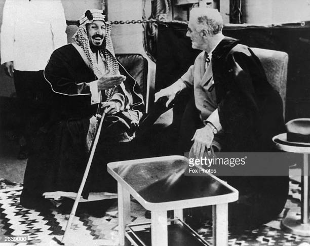 US President Franklin Delano Roosevelt confers with the Saudi King Abdul Aziz Ibn Saud on the deck of an American warship anchored near Cairo