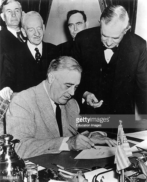 President Franklin Delano Roosevelt Signing The Declaration Of War Against Japan