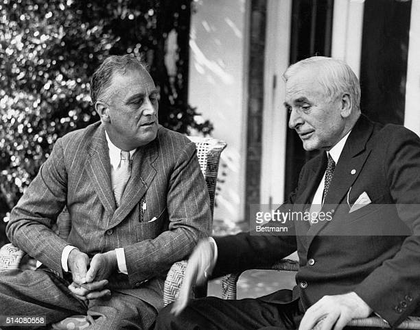 President Franklin Delano Roosevelt speaks with Cordell Hull after Hull's return from the London Economic Conference   Location Hyde Park New York USA