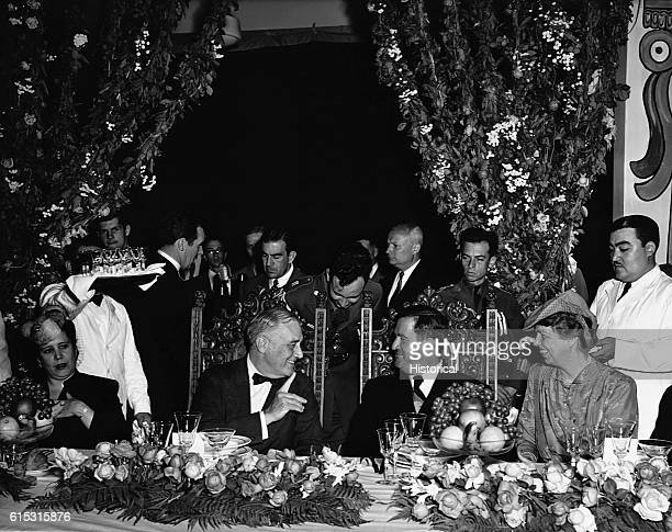 President Franklin Roosevelt and Eleanor Roosevelt attend a dinner party in their honor during their visit to Monterrey Mexico Manuel Avila Camacho...