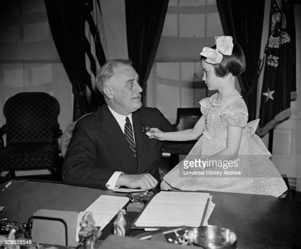 President Franklin Roosevelt being Presented with First Buddy Poppy of Annual National Poppy Sale by 6-year-old Jane Colgan, with Sales Devoted to...