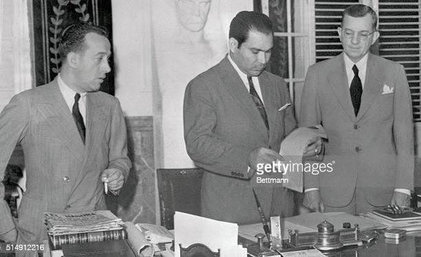 President Fulgencio Batista of Cuba is shown as he was about to sign a Declaration of War between Cuba and Germany and Italy in the Executive Offices...