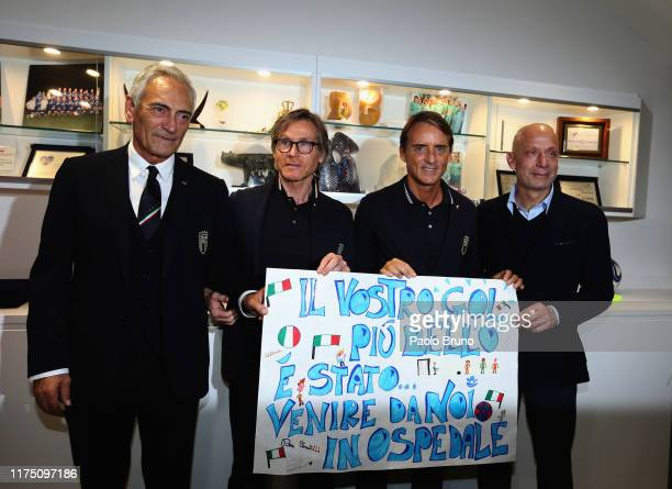 FIGC President Gabriele Gravina Gabriele Oriali Italy head coach Roberto Mancini and Gianluca Vialli visit the 'Bambin Gesu' Hospital on October 10...