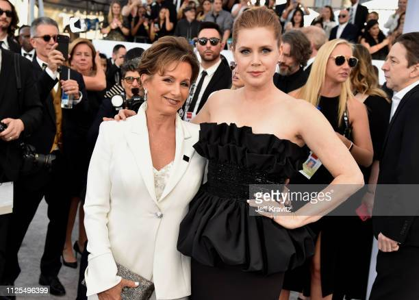 SAGAFTRA President Gabrielle Carteris and Amy Adams attend the 25th Annual Screen Actors Guild Awards at The Shrine Auditorium on January 27 2019 in...