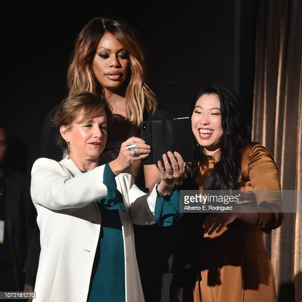 SAGAFTRA President Gabrielle Carteris Laverne Cox and Awkwafina take a selfie onstage during the 25th Annual Screen Actors Guild Awards Nominations...