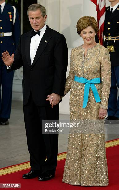 President George Bush and First Lady Laura Bush prepare to greet Poland's President Aleksander Kwasniewski and his wife Jolanta at the White House...