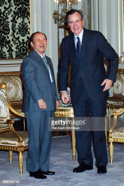US President George Bush and Japanese Prime Minister Kiichi Miyazawa are seen prior to their second meeting at the Akasaka State Guest House on...