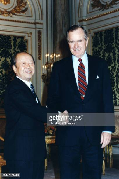US President George Bush and Japanese Prime Minister Kiichi Miyazawa shake hands prior to their meeting at the Akasaka State Guest House on January 8...