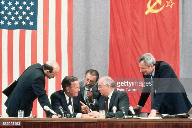 US President George Bush and Soviet leader Mikhail Gorbachev laugh together at a joke during the 1991 Moscow Summit