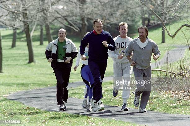 US President George Bush jogs on March 21 1990 with actor Chuck Norris and his son Michael Norris at the US Naval Observatory in Washington AFP PHOTO...