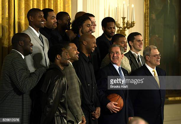 President George Bush meets with the Los Angeles Lakers at the White House Bush is giving them a belated congratulations on the team's 2000 and 2001...