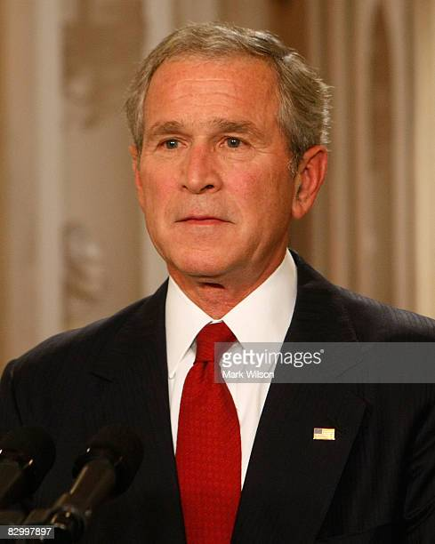 US President George Bush poses for photographers moments after speaking to the nation from the White House September 24 2008 in Washington DC...