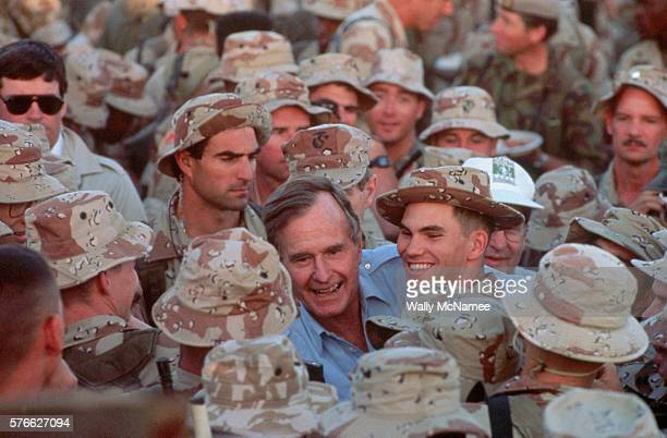 President George Bush shakes hands with US Army troops in Saudi Arabia during the Gulf War on Thanksgiving Day 1990