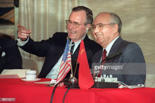 US President George Bush shares a joke with Soviet leader Mikhail Gorbachev on December 03 1989 on board the soviet cruise Maxim Gorki shipdocked at...