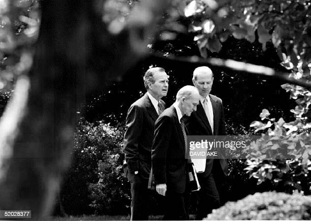 S President George Bush speaks with National Security Adviser Brent Scowcroft and Secretary of State James Baker as they walk back to the White House...