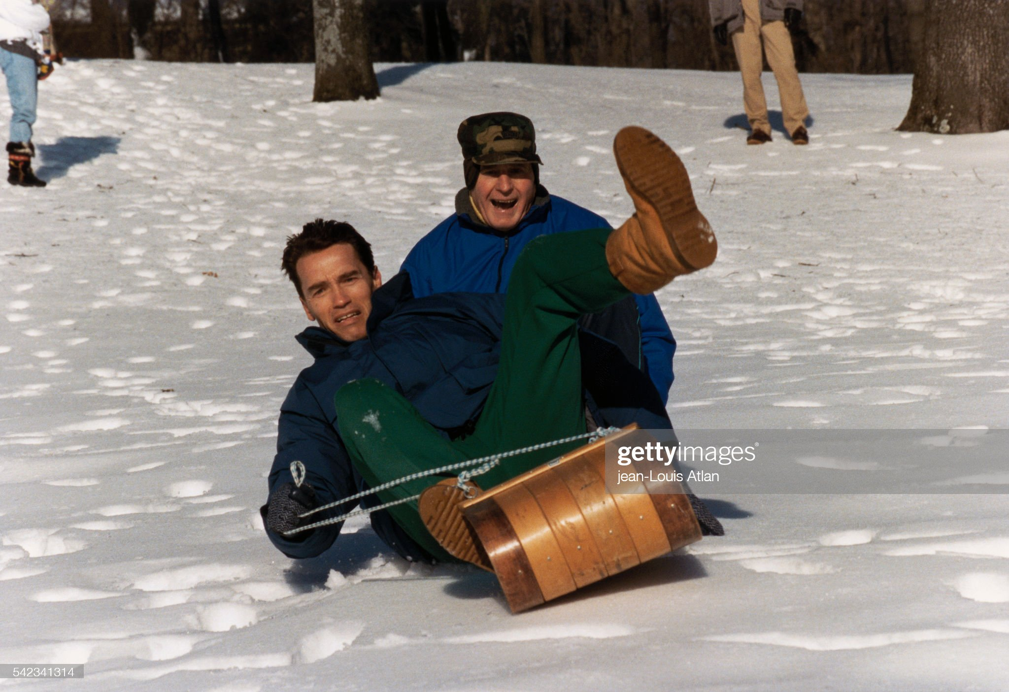 George Bush Relaxes in Snow with Arnold Schwarzenegger : News Photo