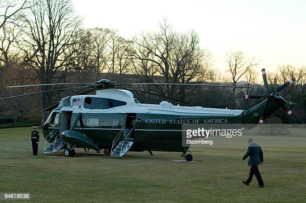 President George Bush walks across the south lawn of the White House to Marine One as he departs for a tour of the Alabama region damaged by the...