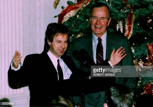 U S President George Bush watches as comedian Dana Carvey does his George Bush impersonation 07 December 1992 Carvey and his wife Paula spent the...
