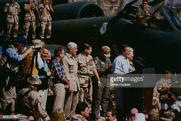 President George H. W. Bush and First Lady Barbara Bush celebrate Thanksgiving with the US Marines in Saudi Arabia, during the Gulf War, 22nd...