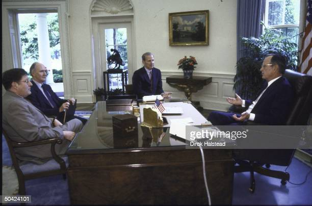President George H W Bush seated at a meeting in the Oval Office with Chief of Staff John H Sununu NSC Adviser Brent Scowcroft and State Secretary...