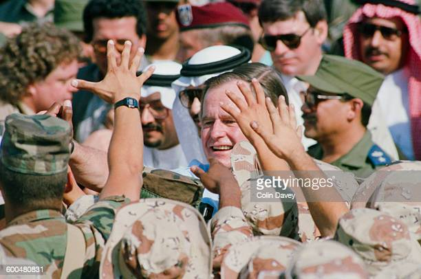 US President George H W Bush visits the US troops in Saudi Arabia during the Gulf War circa 1990