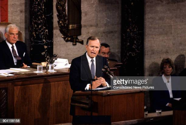 US President George HW Bush addresses a joint session of the US Congress Washington DC September 11 1990 At left is Speaker of the House Tom Foley