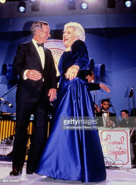 President George HW Bush and First Lady Barbara Bush share a laugh on stage during one of their Inaugural Balls, Washington DC, January 20, 1989.