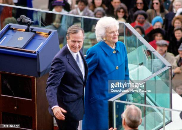 President George HW Bush and First Lady Barbara Bush smile at the crowd after the former's Inauguration at the US Capitol, Washington DC, January 20,...