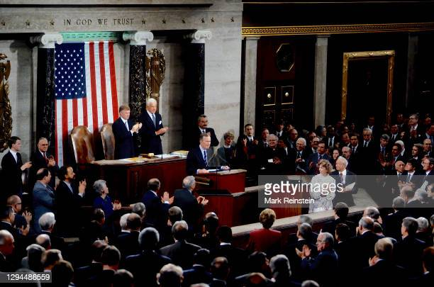 President George H.W. Bush delivers his final address Before a Joint Session of the Congress on the State of the Union, to a standing ovation lead by...