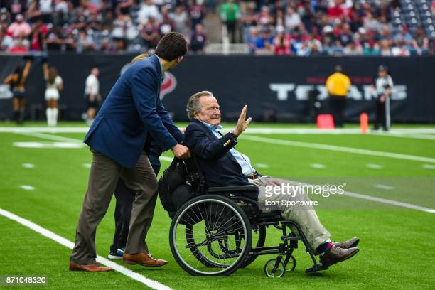 President George HW Bush departs the field before the football game between the Indianapolis Colts and the Houston Texans on November 5 2017 at NRG...