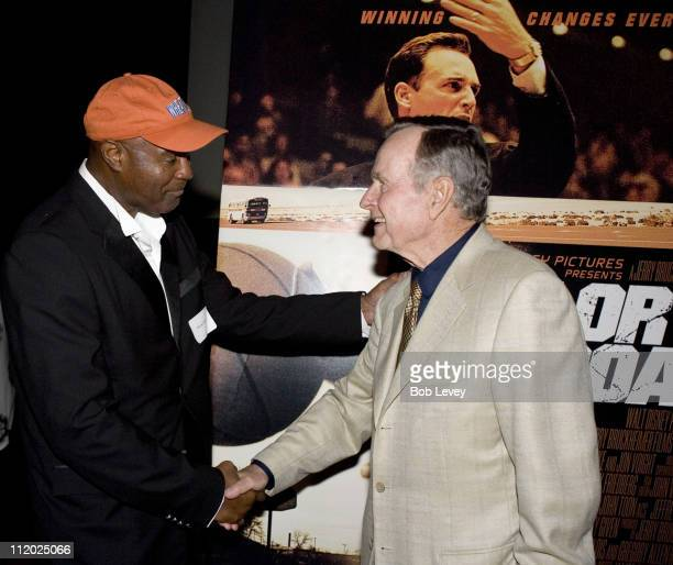 President George HW Bush greets former Texas Western player David Lattin as he hosted a private screening of Disney's 'Glory Road' for local college...