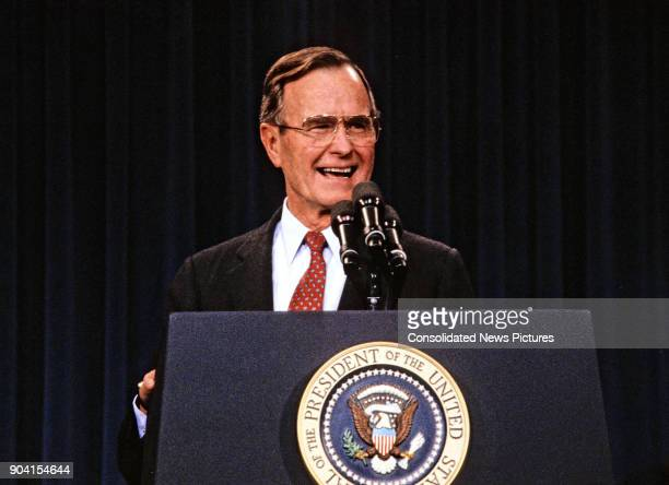 President George HW Bush laughs as he speaks during a White House press conference, Washington DC, February 6, 1989. His speech addressed a savings...