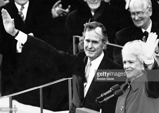 President George HW Bush left and his wife First Lady Barbara Bush wave from the platform after being sworn in as the 41st President of the United...