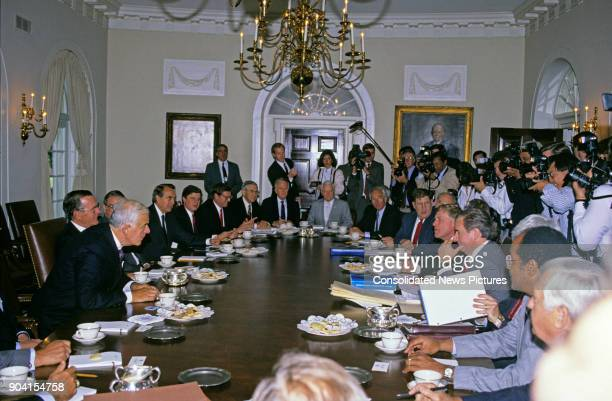US President George HW Bush meets with Congressional budget negotiators in the White House's Cabinet Room Washington DC May 15 1990 Among those...